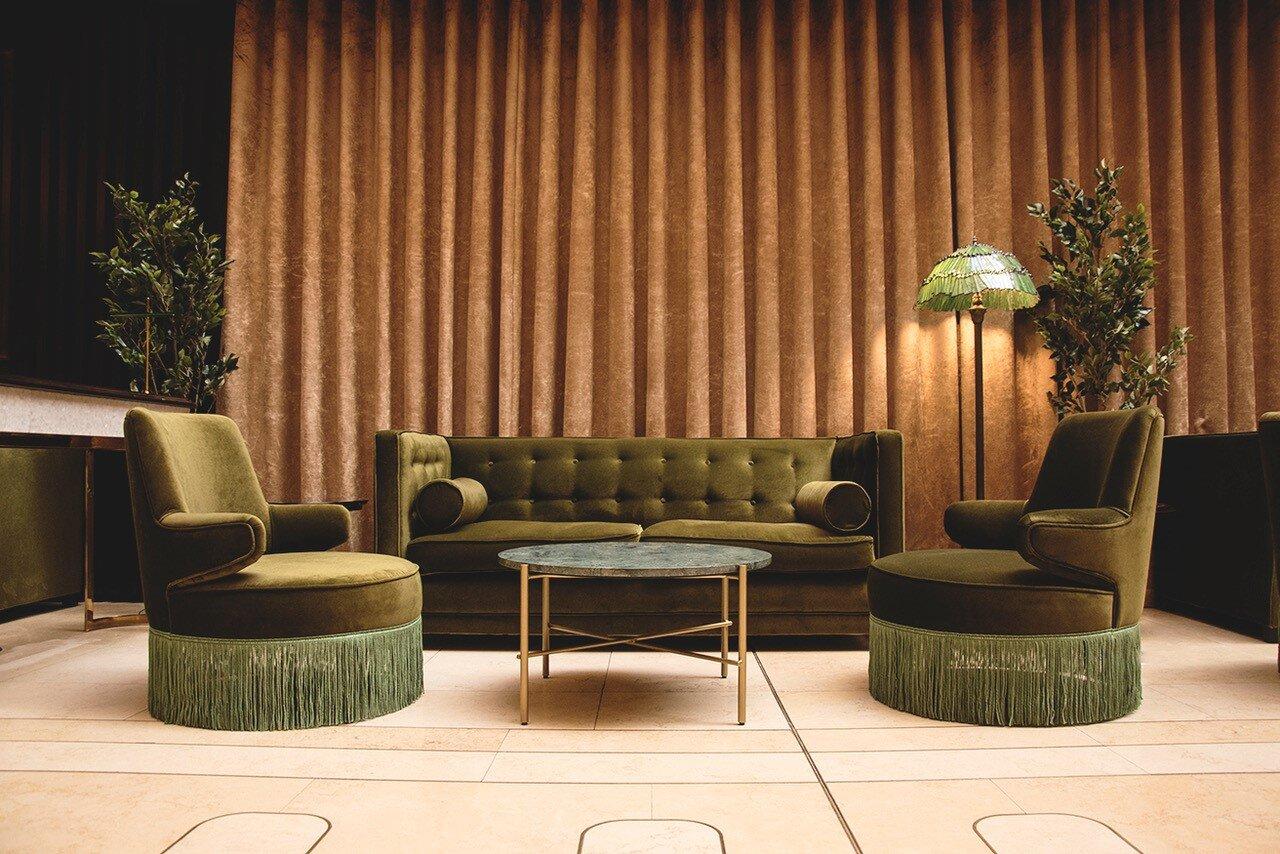 jin bar dorsett hotel interior design vintage sofa tassel
